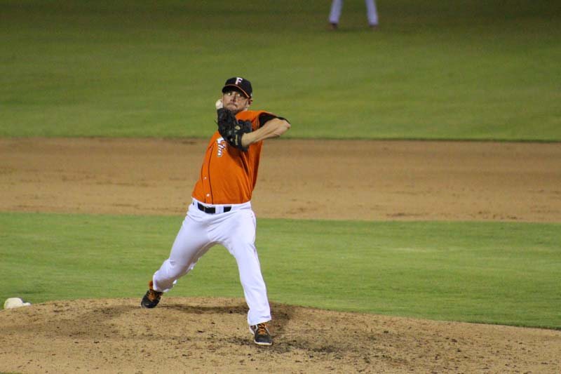 Fresno Grizzlies pitcher mid-throw