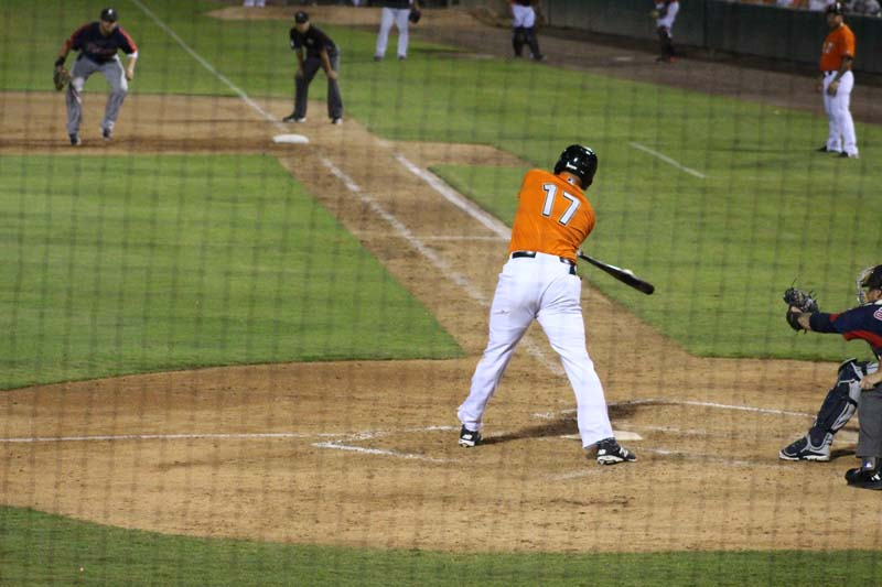 Fresno Grizzlies player hitting the ball